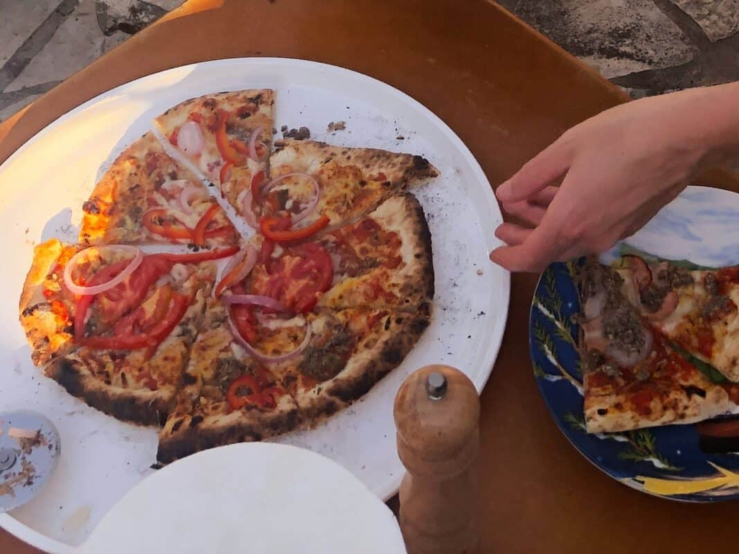 Serving a finished pizza